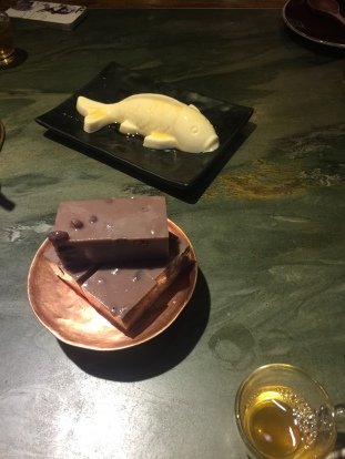 Moulded fish (tasted like a milky blancmange) & Red bean 'Cake' Foreground: Pear Tea